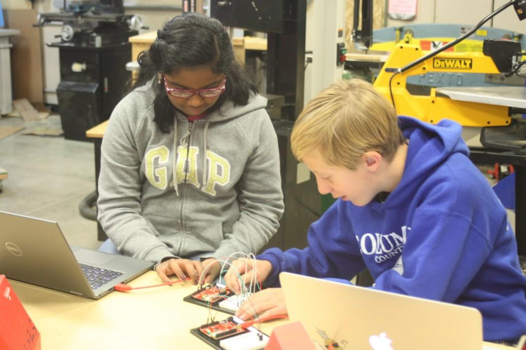 Sixth grade engineering students program Arduino robot boards to be able to sense temperature.