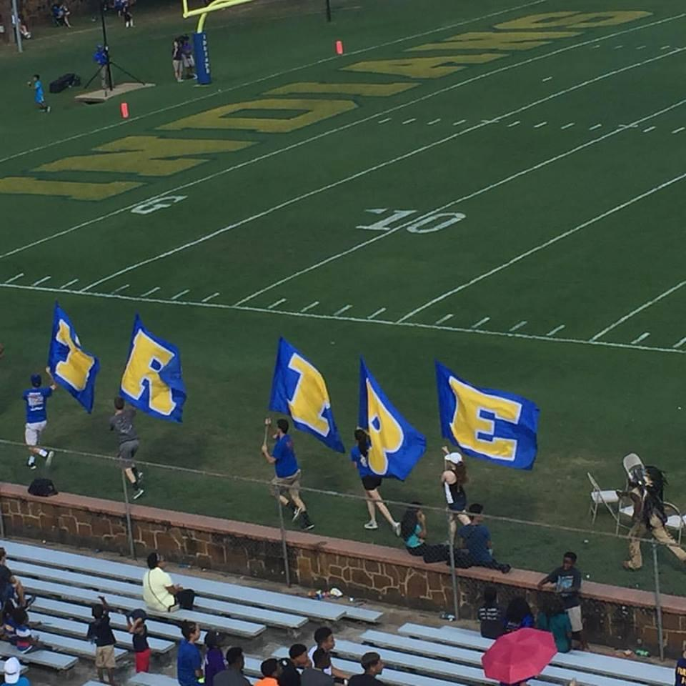 flag runners with flags after a touchdown