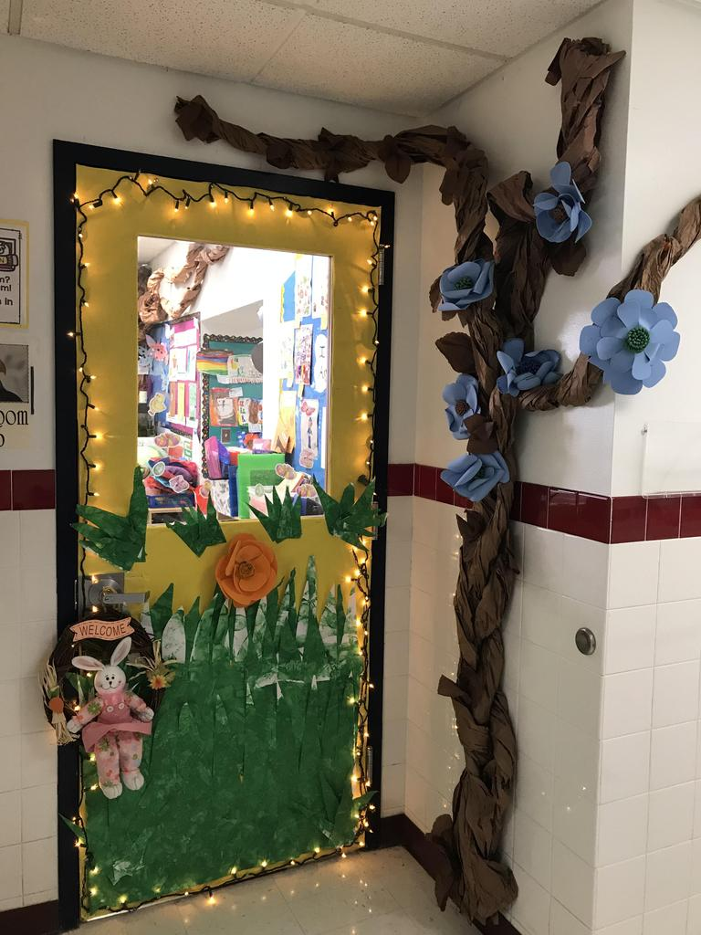 happy spring door display with large paper tree and flowers