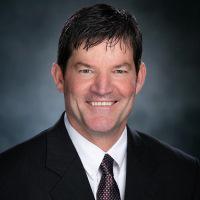 Headshot of interim AD Bobby Lee