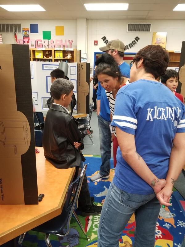 boy talking to teachers