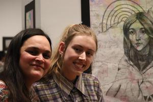 woman and teen girl in front of painting