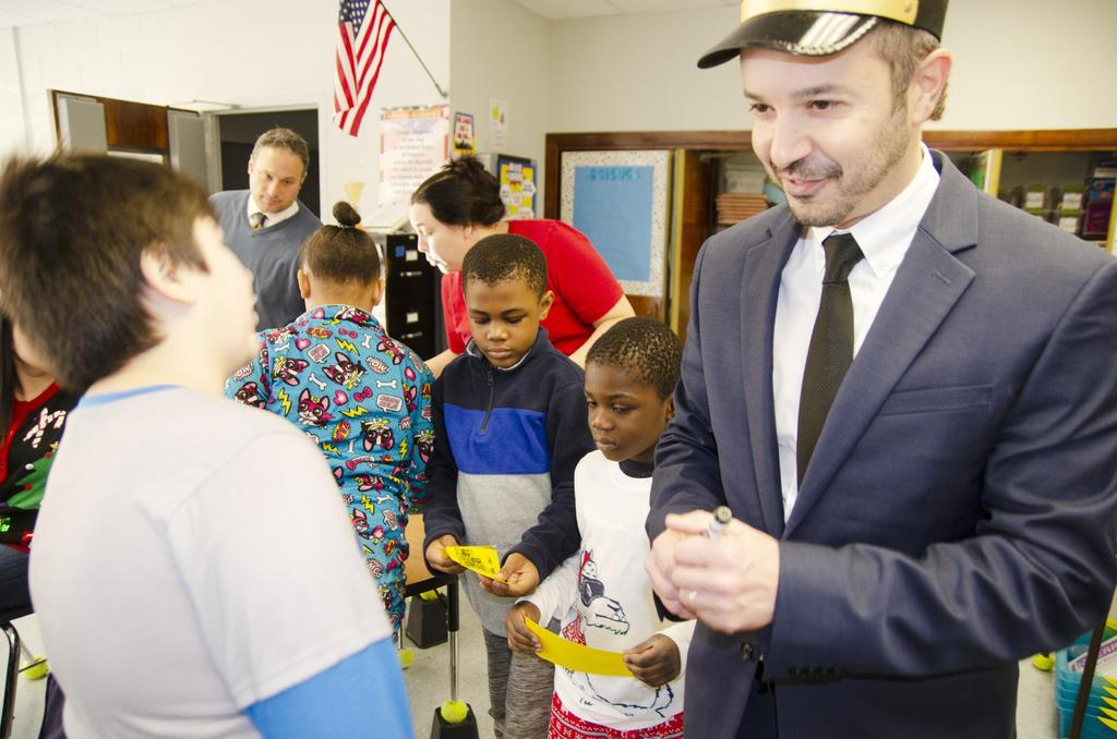 The Polar Express conductor talks to a student