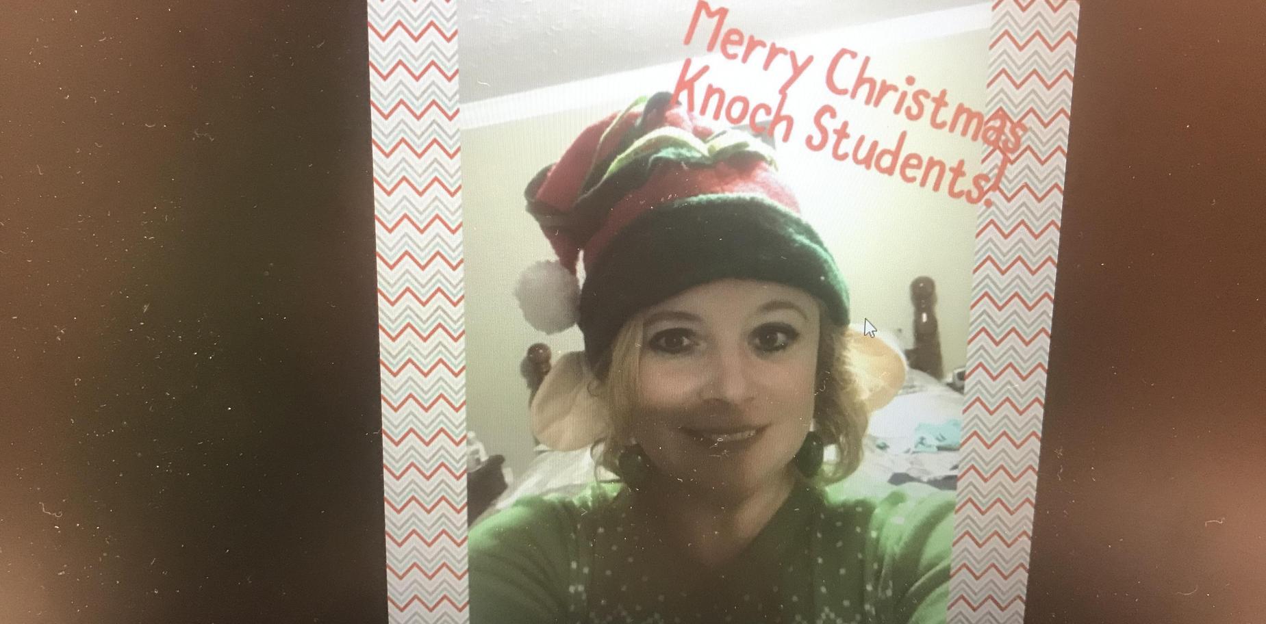 Mrs. White in elf hat