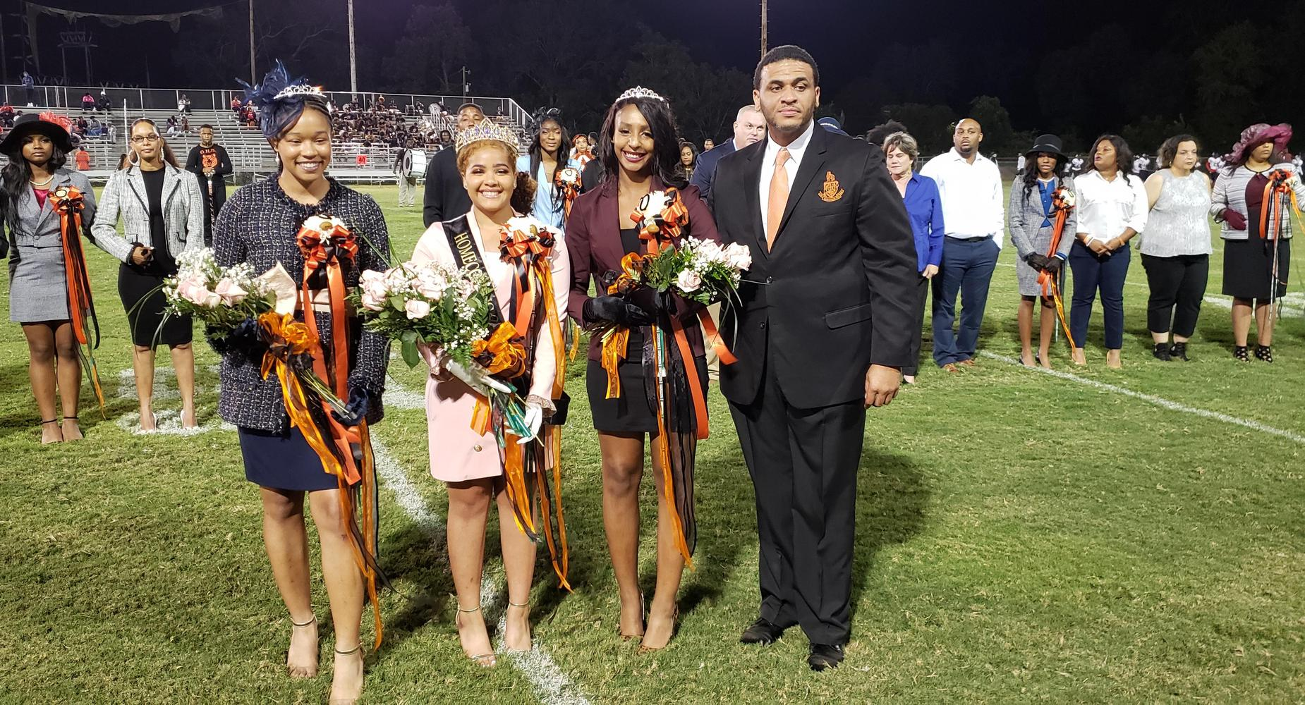 First Maid Bailey Willis, Homecoming Queen Blaire Collins, Second Maid Courtney Lafontaine with Mr. Julien