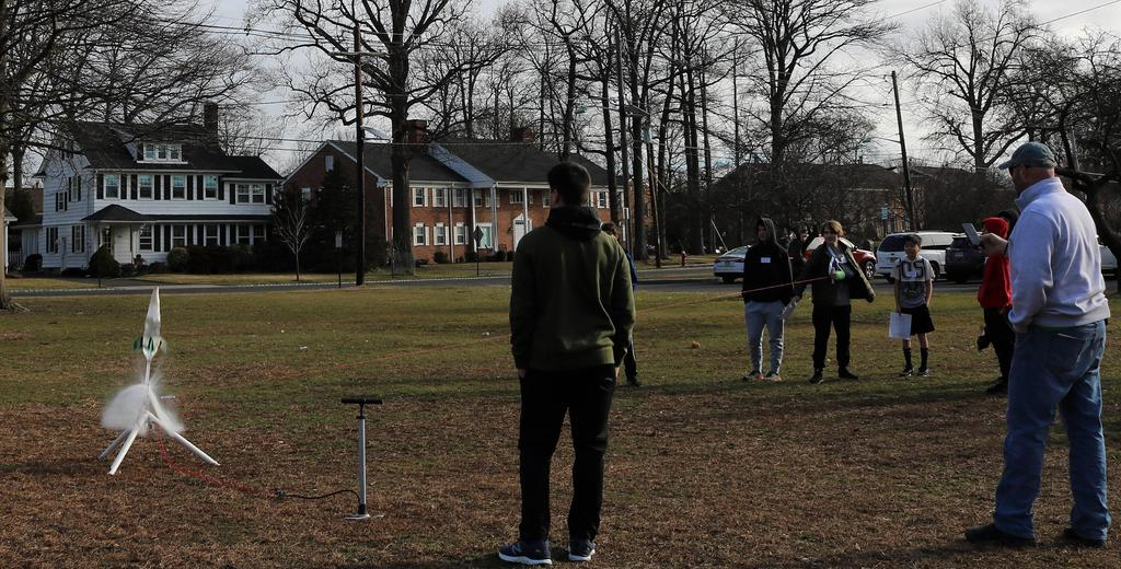 Photo of student getting ready to launch rocket during Science Olympiad at Roosevelt Intermediate School, as others look on.