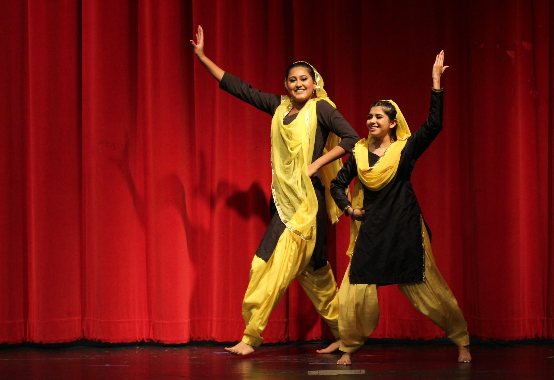 Stephanie Ponce and Sukhpreet Kaur dancing