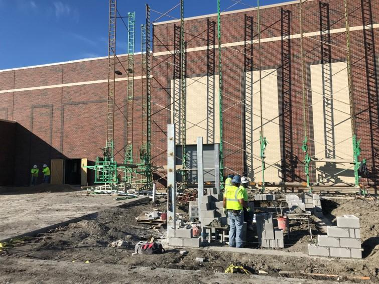 scaffolding by brick on exterior of Simpson Elementary