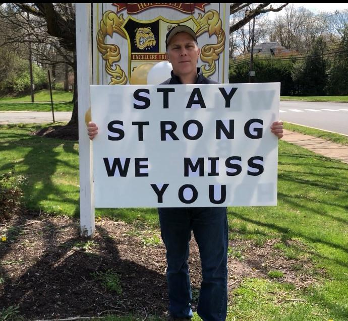 HVRSD Superintendent of Schools holding Stay Strong sign