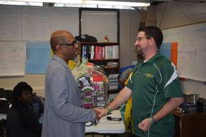 Superintendent Ellis gives Acts of Kindness Baskets to employees