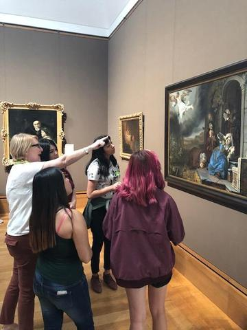 Docent points out important features of art piece