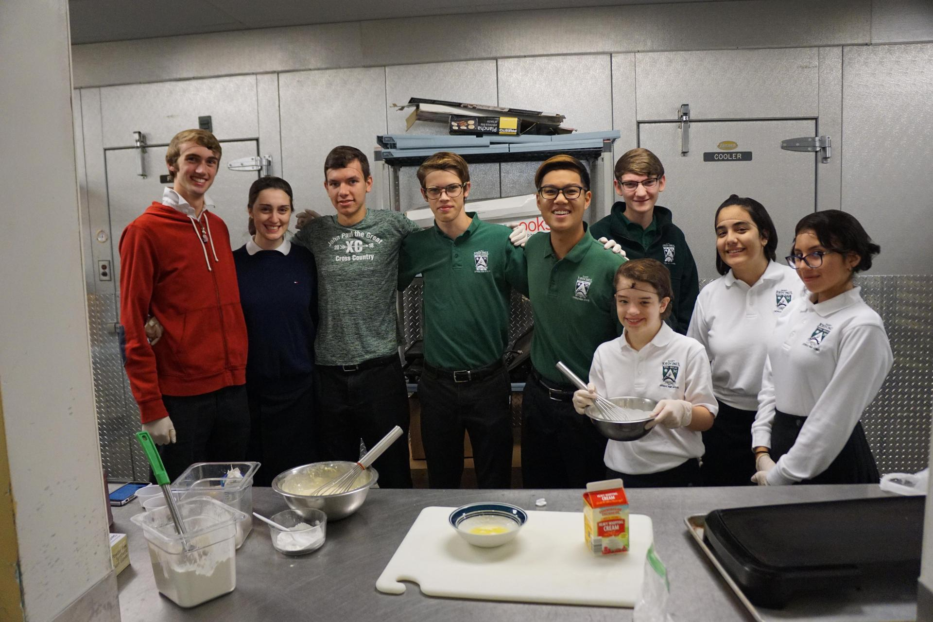 Members of the cooking club gathered in the kitchen