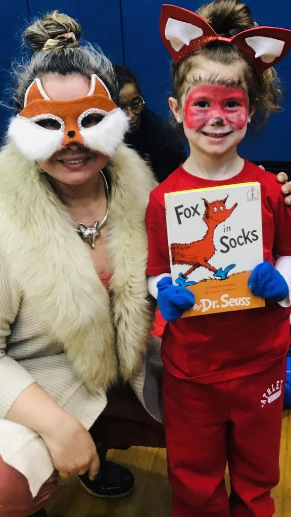 parent liaison dressed as a fox with girl from fox and socks class