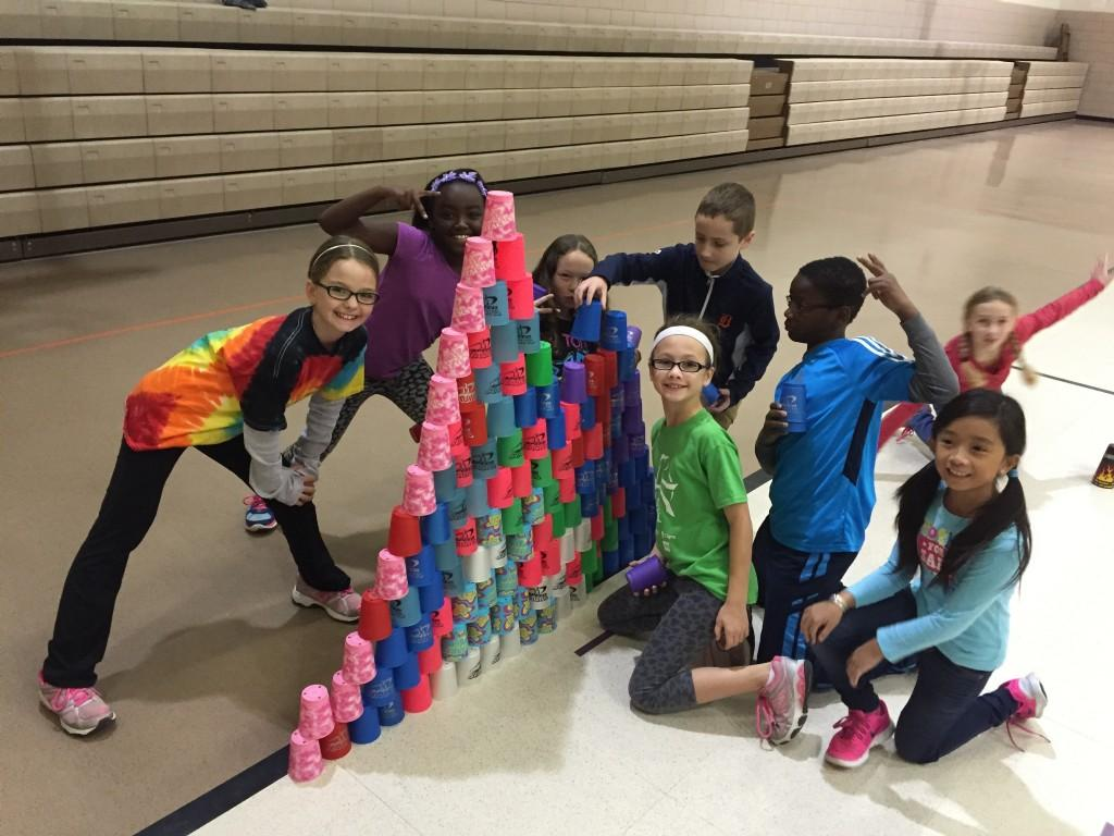 students stack cups high