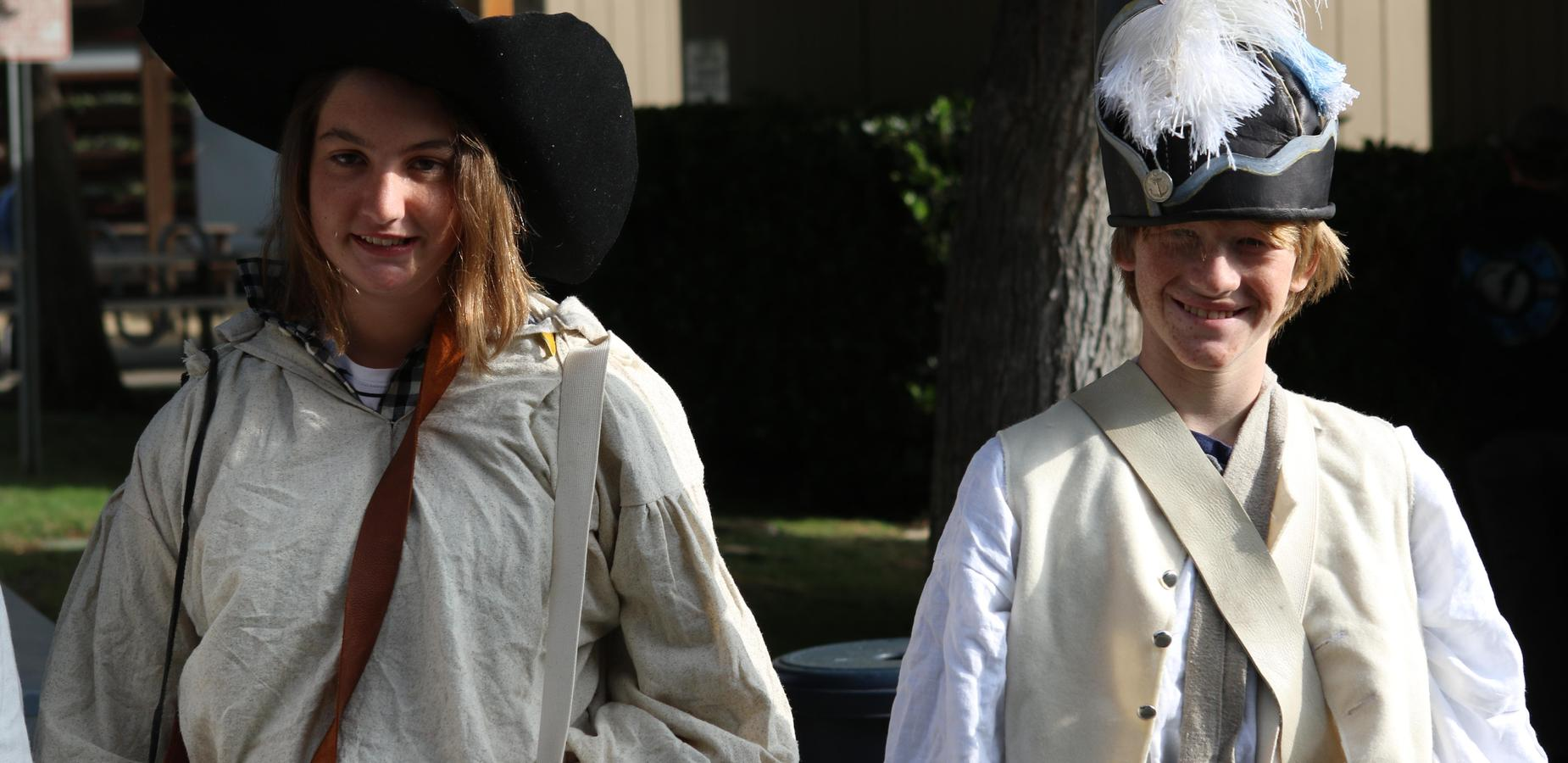 Students dressed in clothing that resembles items worn during the revolutionary war.