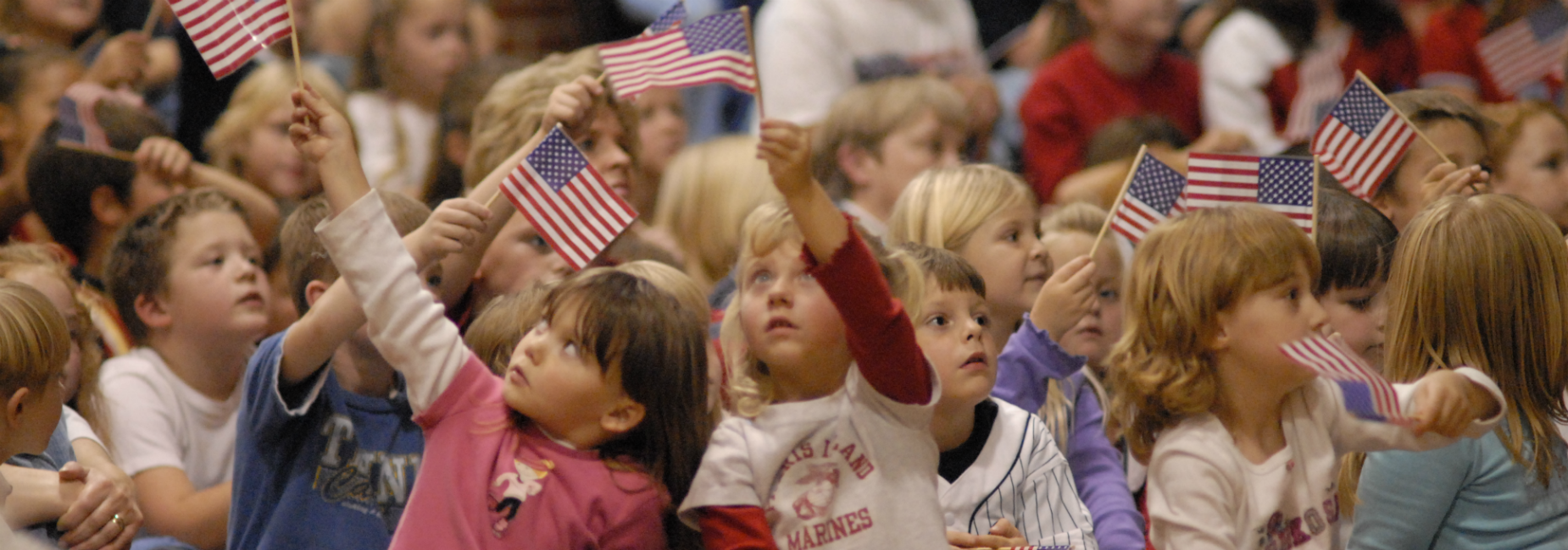 Children holding up American flags.