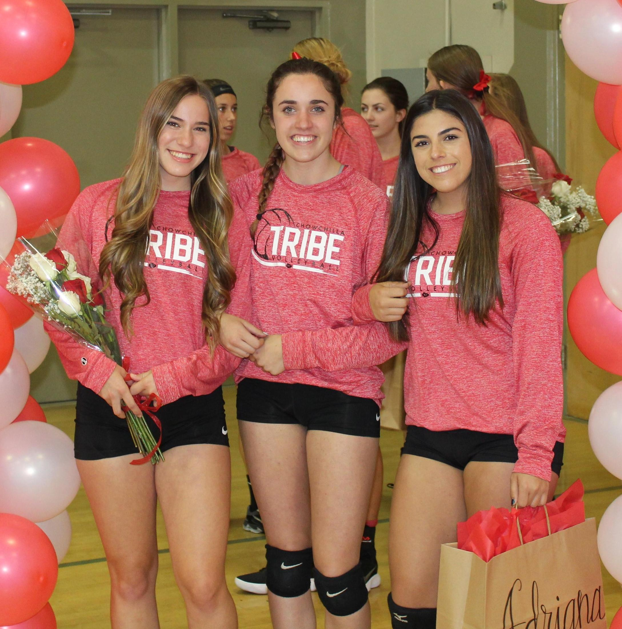 Christins Fuller and Kyler Kahl escort Adrianna Felsinger on Volleyball Senior Night.