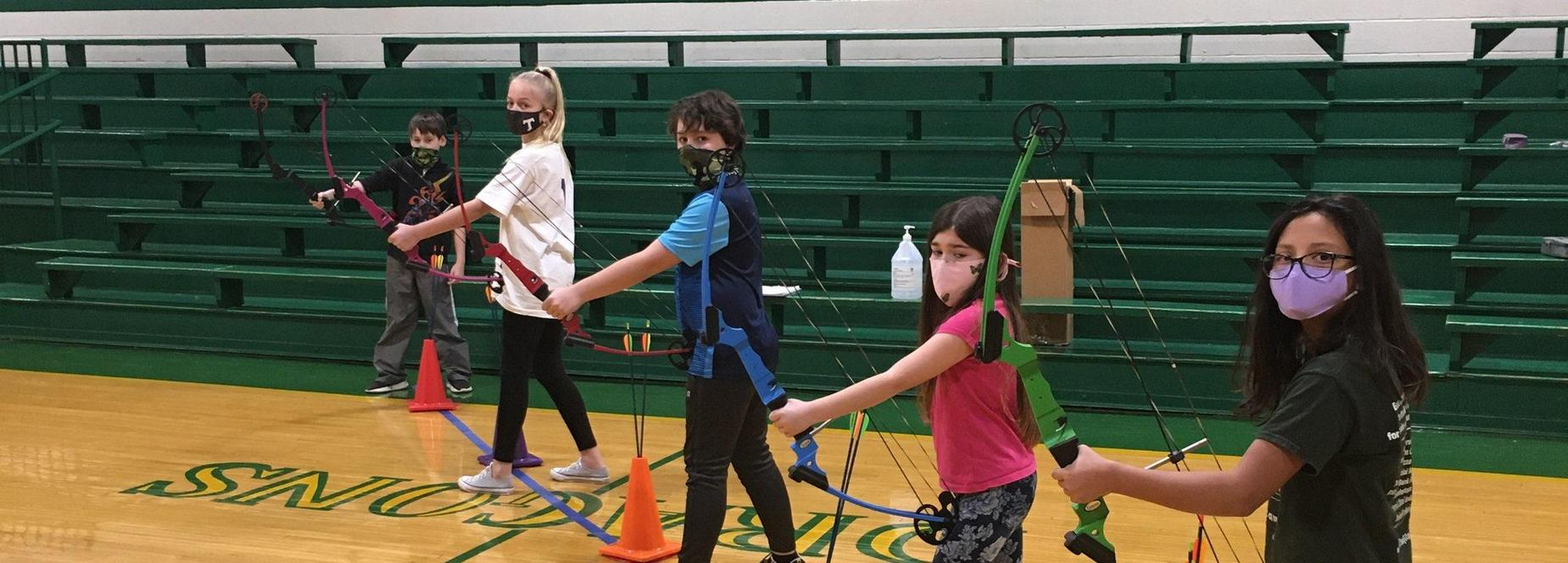 4th graders learning about archery!