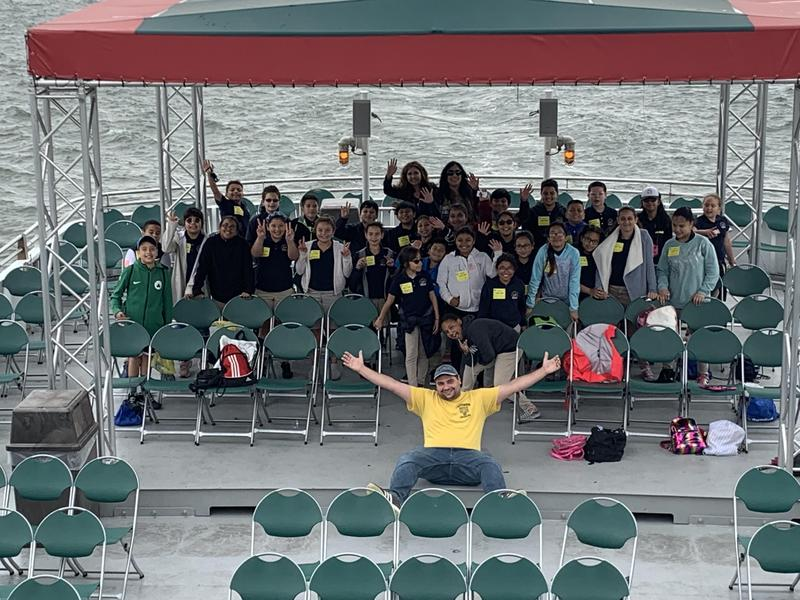 group photo at the back of the boat