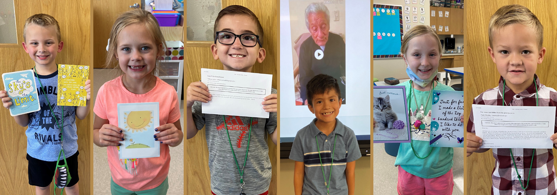 6 young students holding greeting cards from their grandparents