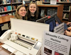 "Photo of: Roosevelt Intermediate School 7th graders Caroline Sullivan (left) and Catherine Durocher enjoy ""Maker Day"" on March 21."