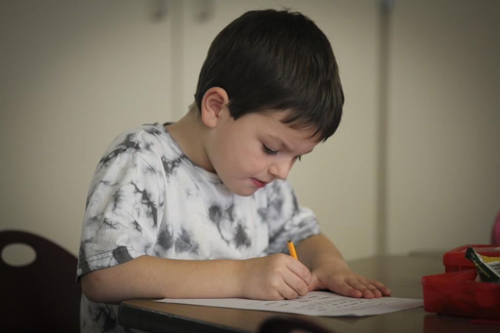 boy with pencil in class