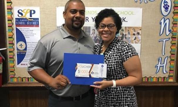 Marlin Jones from St Landry Homestead brought in donations of clipboards and vouchers for the faculty and staff of Leonville Elementary School. Pictured with Mr. Jones and Dr. Nicole Morrison Davis, Principal of Leonville Elementary School.