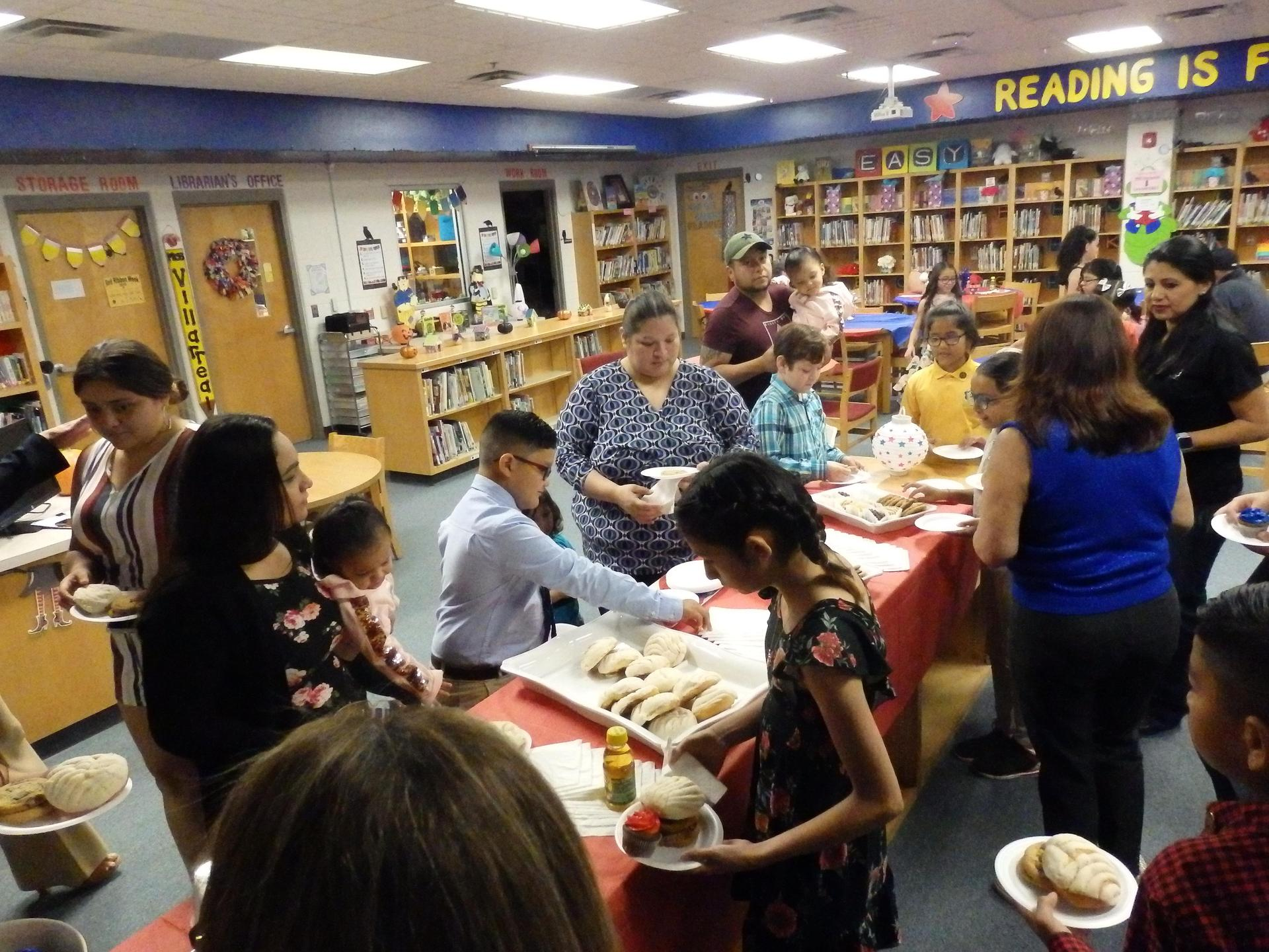 Parents celebrate with their child after student council induction