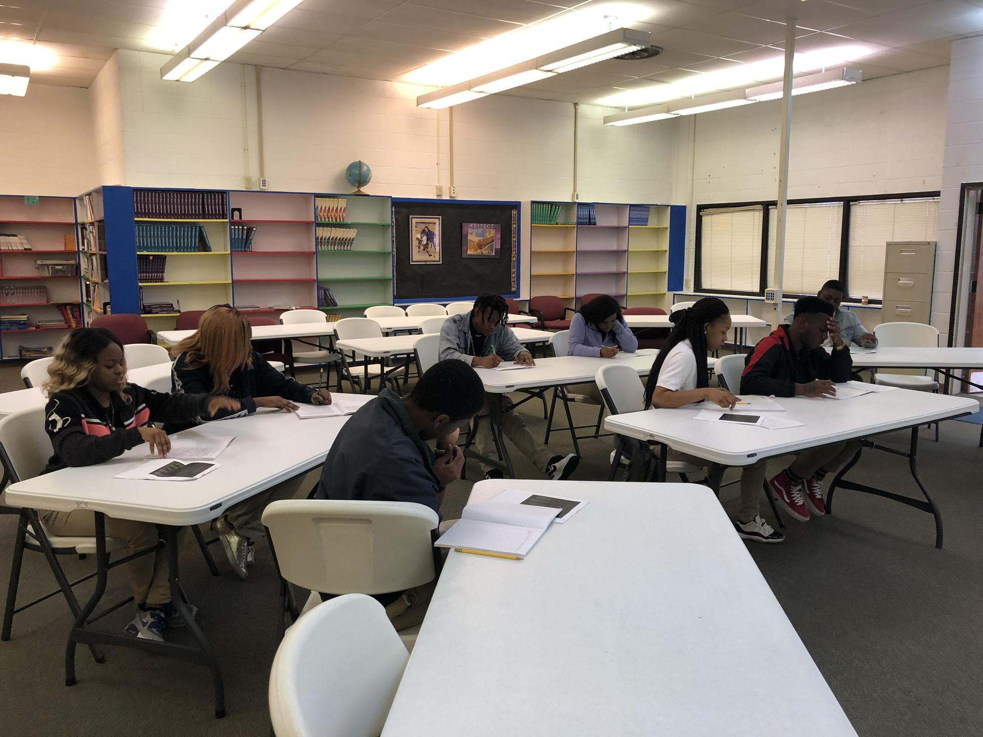 Students engaged in writing