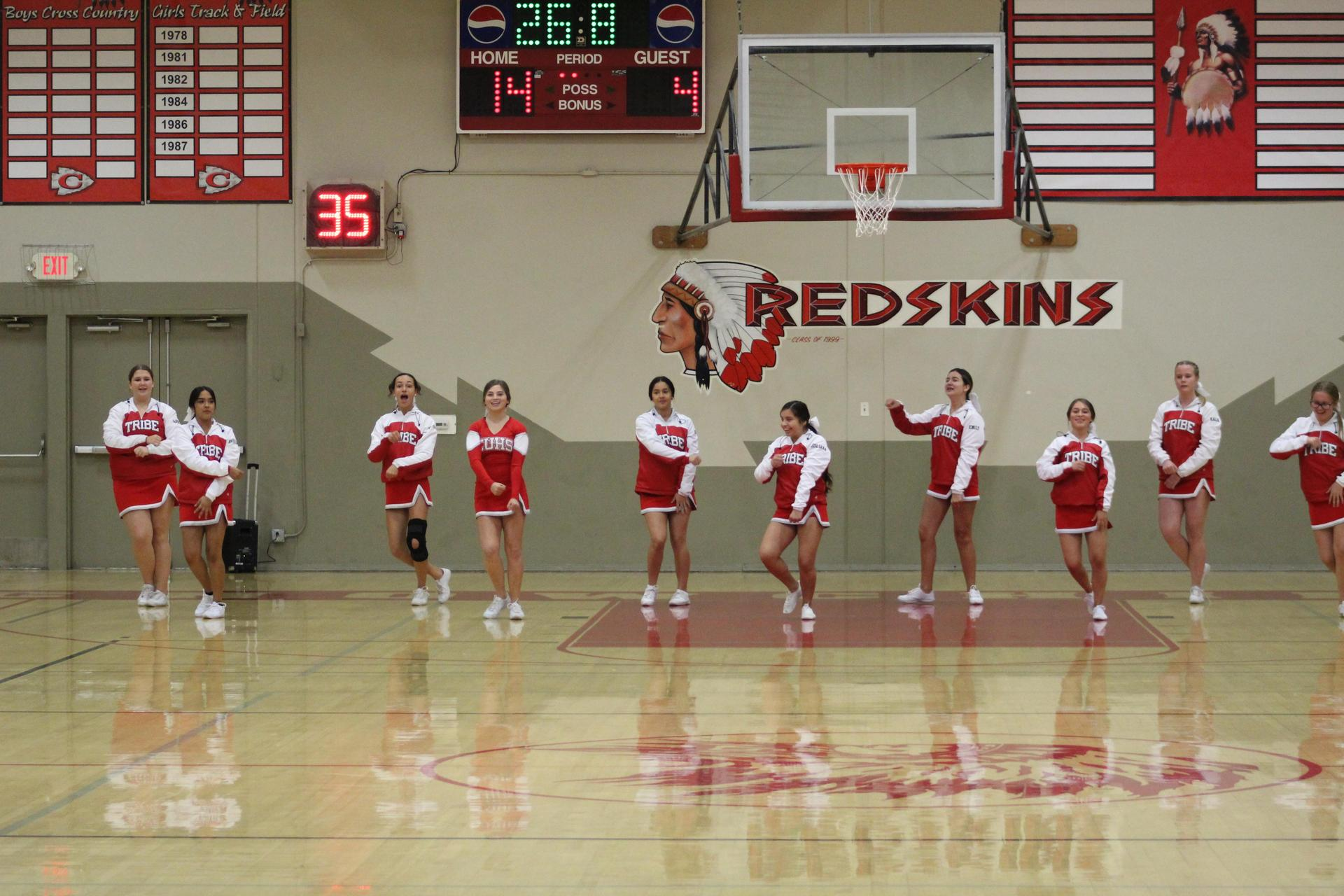 Junior varsity cheer performing at Mendota Basketball game