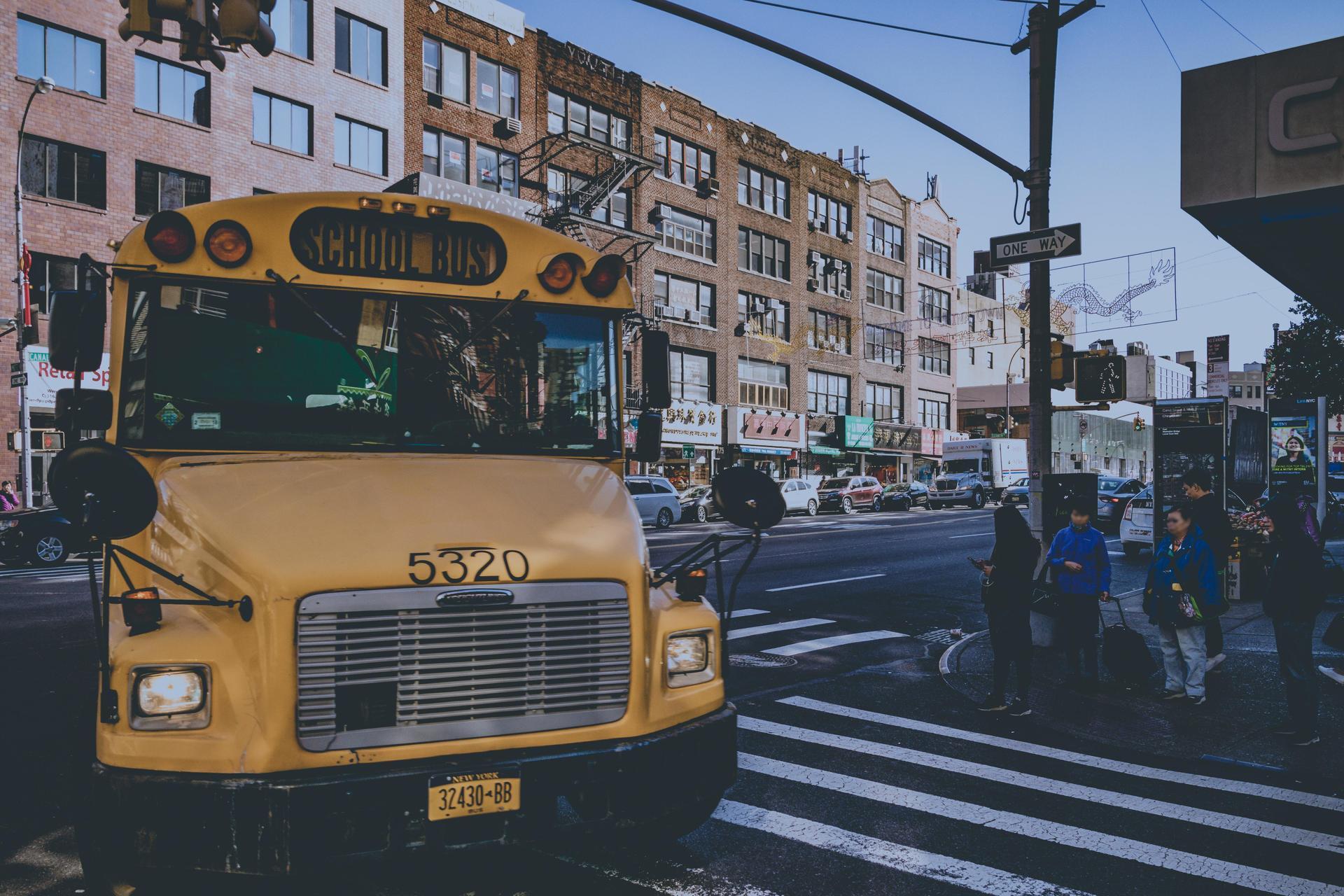 Yellow school bus on city street