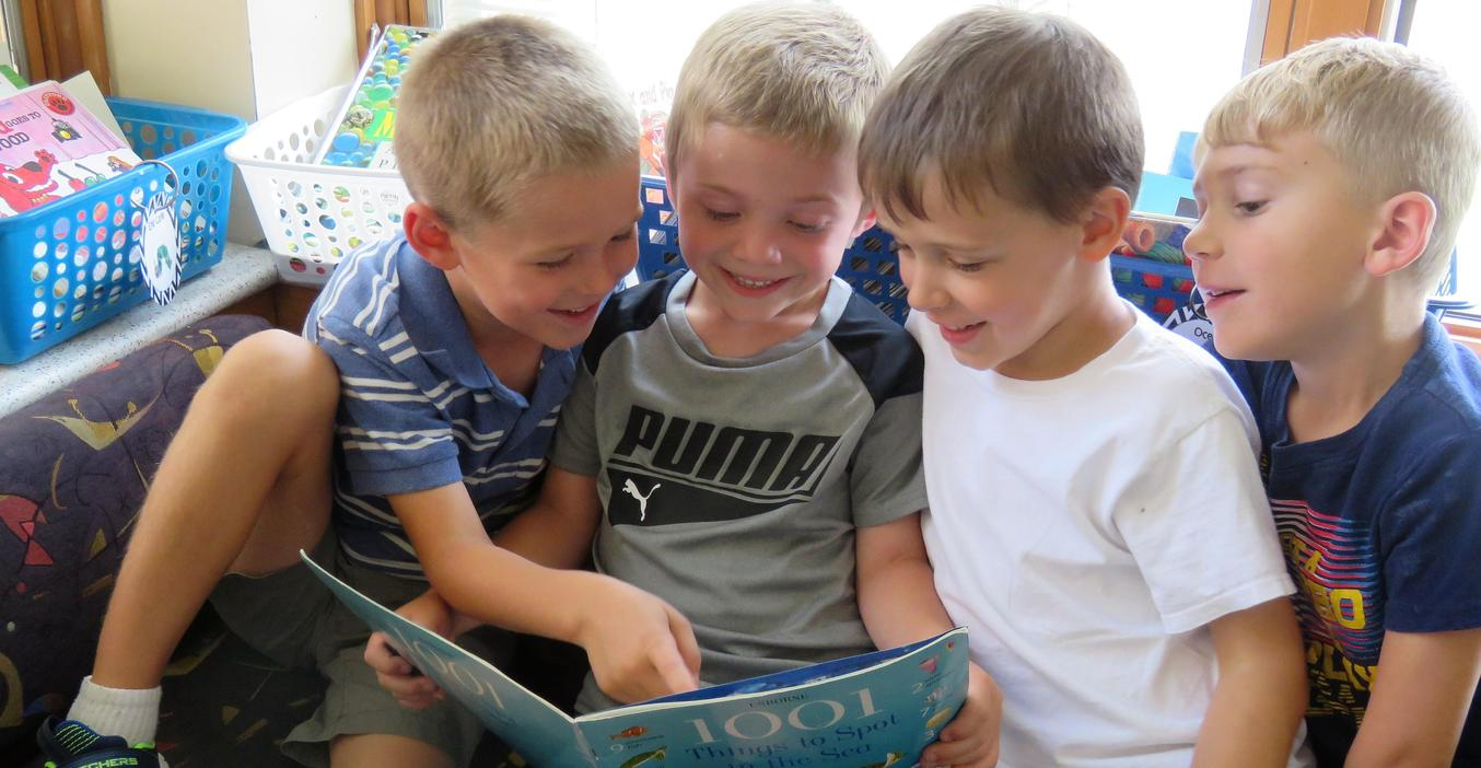 These boys read together at McFall.