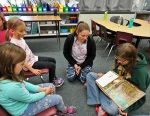 TKMS students share books about water with McFall first graders.