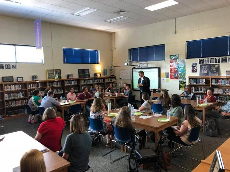 group of new teachers discussing their first week of school with Mr. Tony Clower