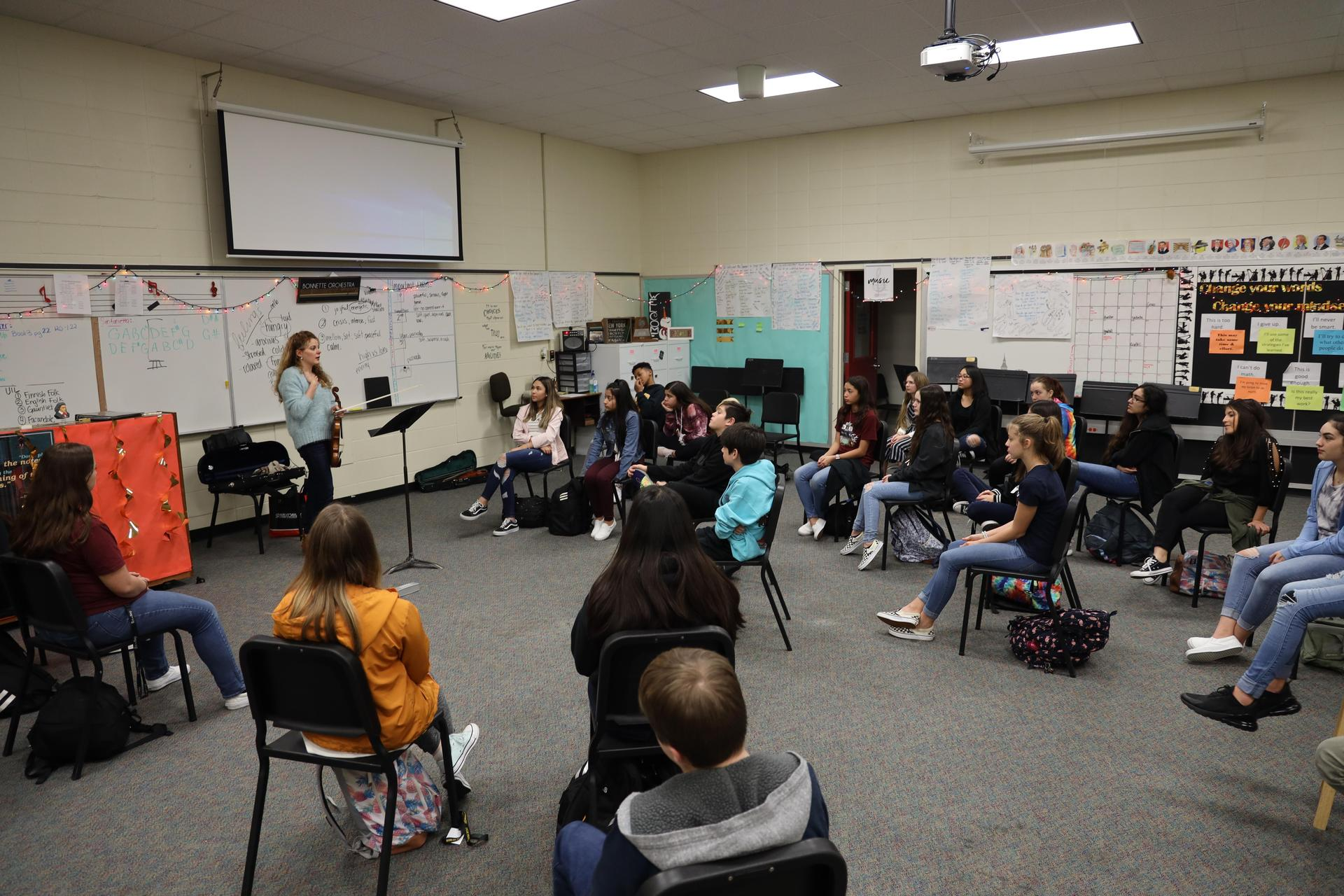 Violinist Patricia Quintero visits with Bonnette Junior High students