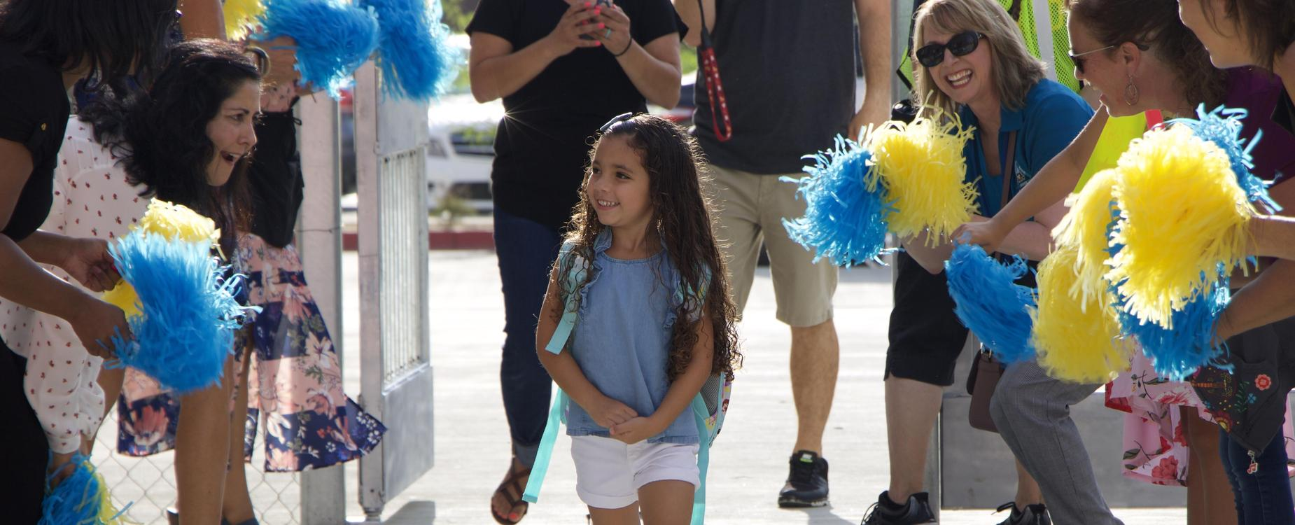Students welcomed by staff to school