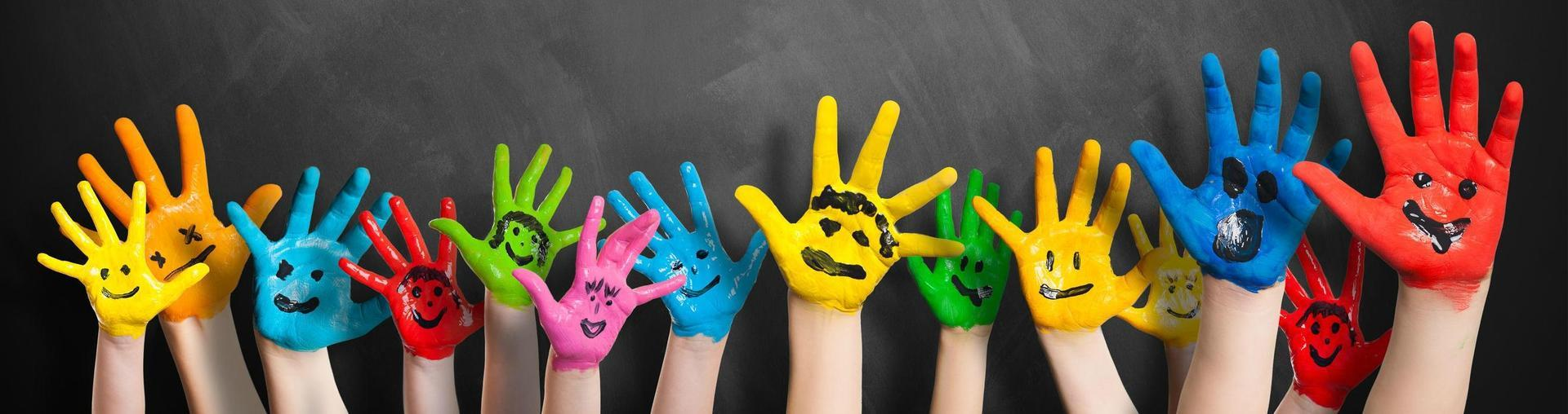 Happy Faces painted on hands.