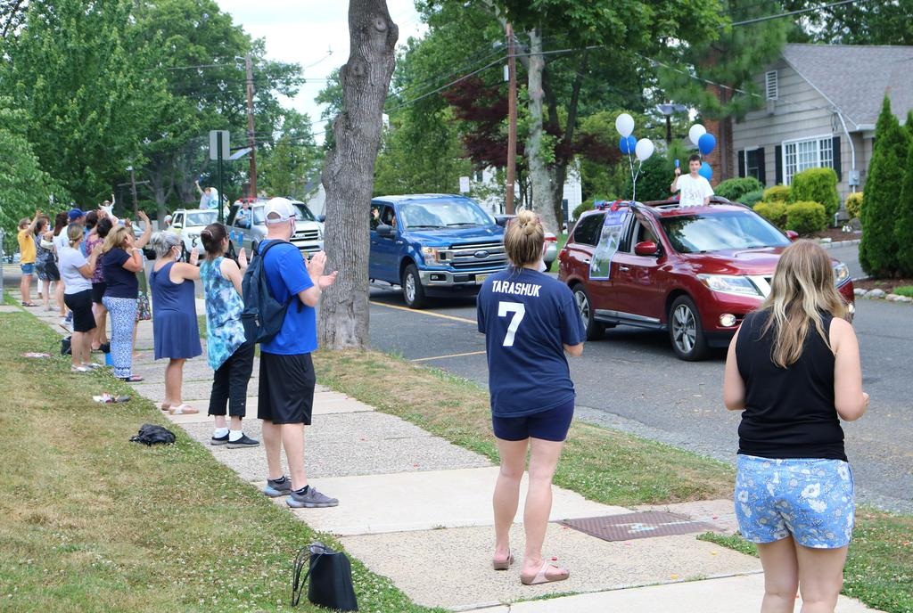 Photo of cars and teachers lined up for Wilson Grade 5 Clap Out Car Parade
