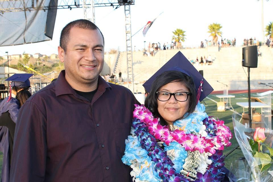 A graduate with a family member