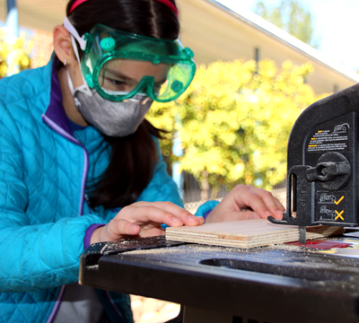 Girls using a table saw