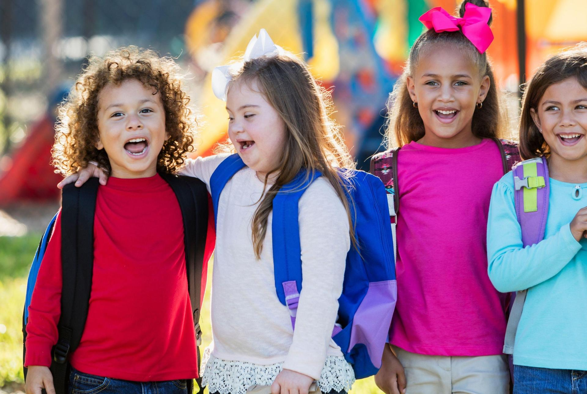 four girls playing on playground