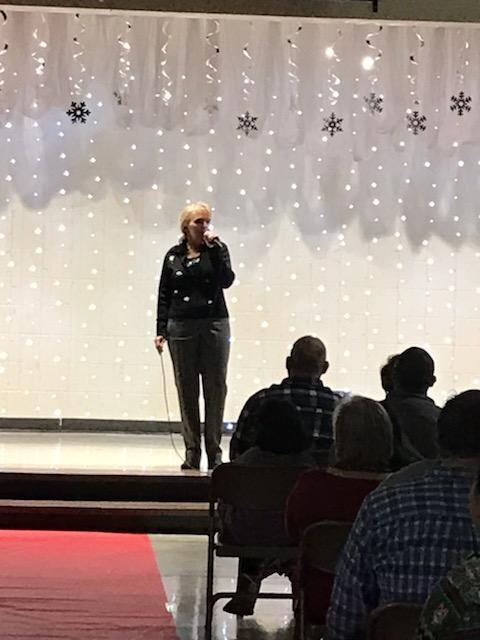 Dr. Hall singing at Talent Show.