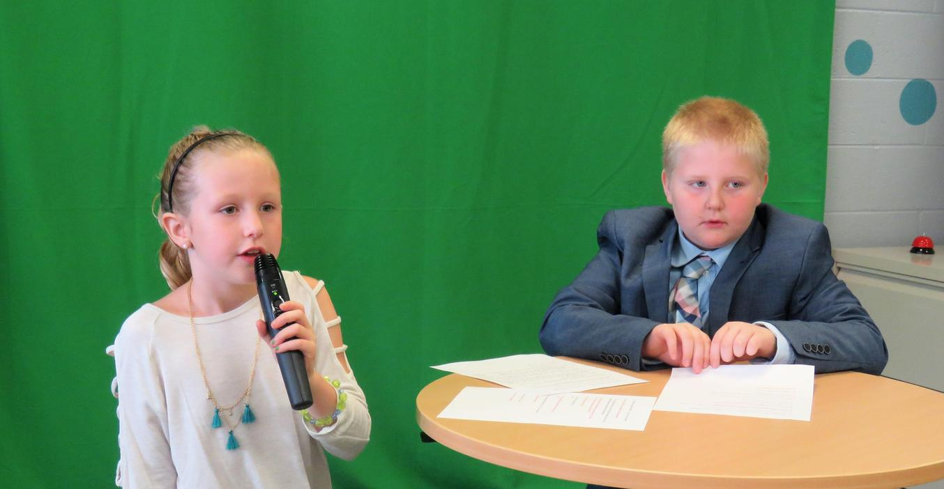 Lee Elementary student prepare recorded video announcements.