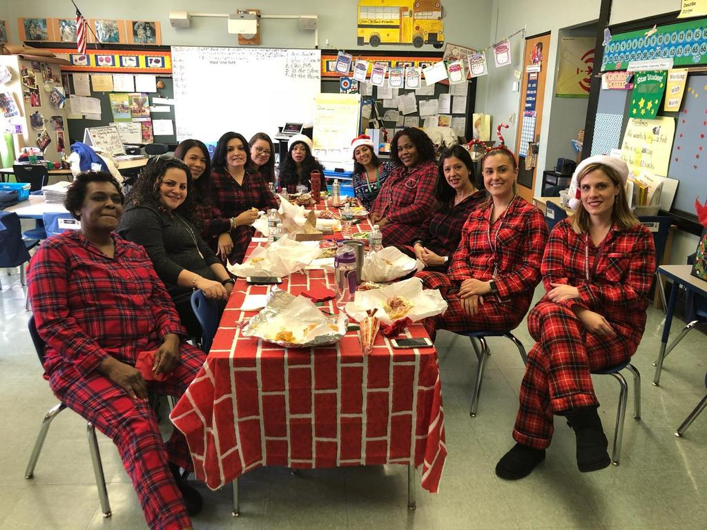 teachers in their pj's having a holiday breakfast