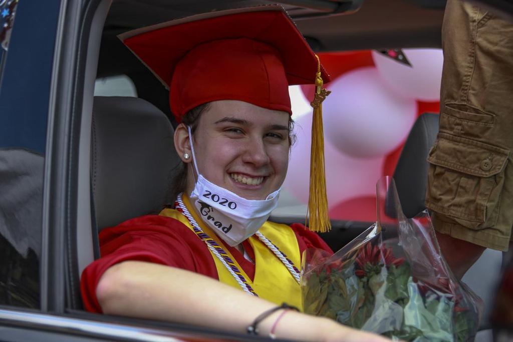 Graduate in a passenger seat