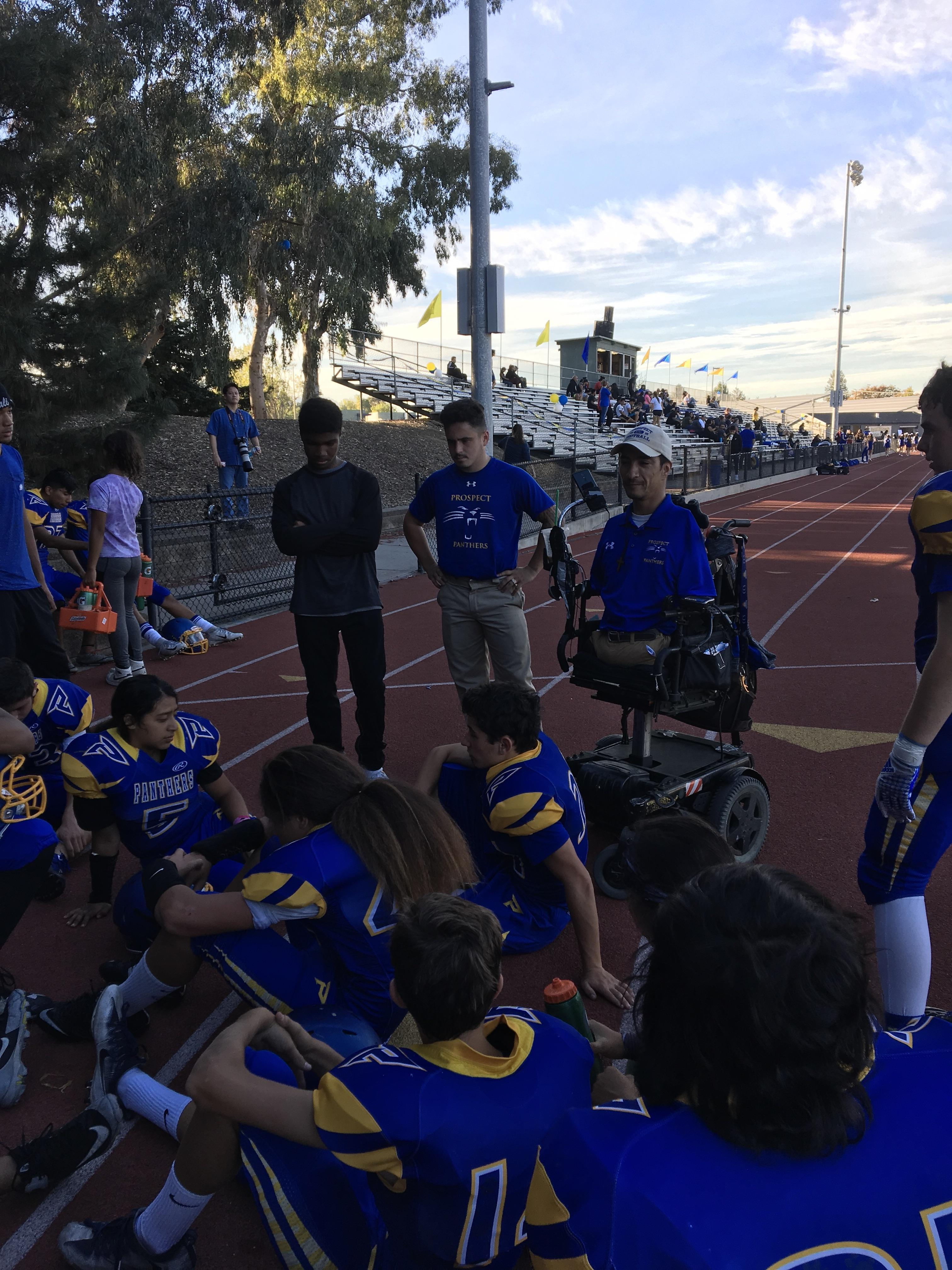Coach Rob Mendez talking to his team during halftime