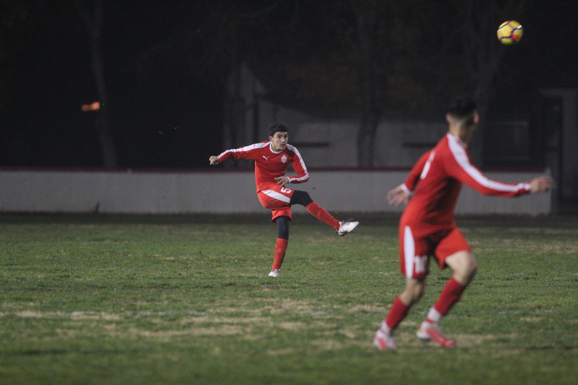 boys playing soccer against livingston