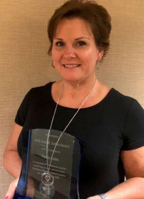 compressed Paula Cobb receives Orus Sutton Award.jpg