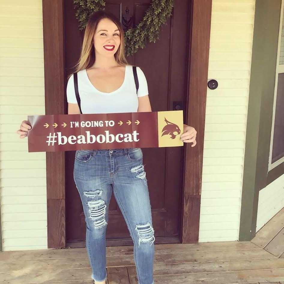 Shannon holding Texas State sign