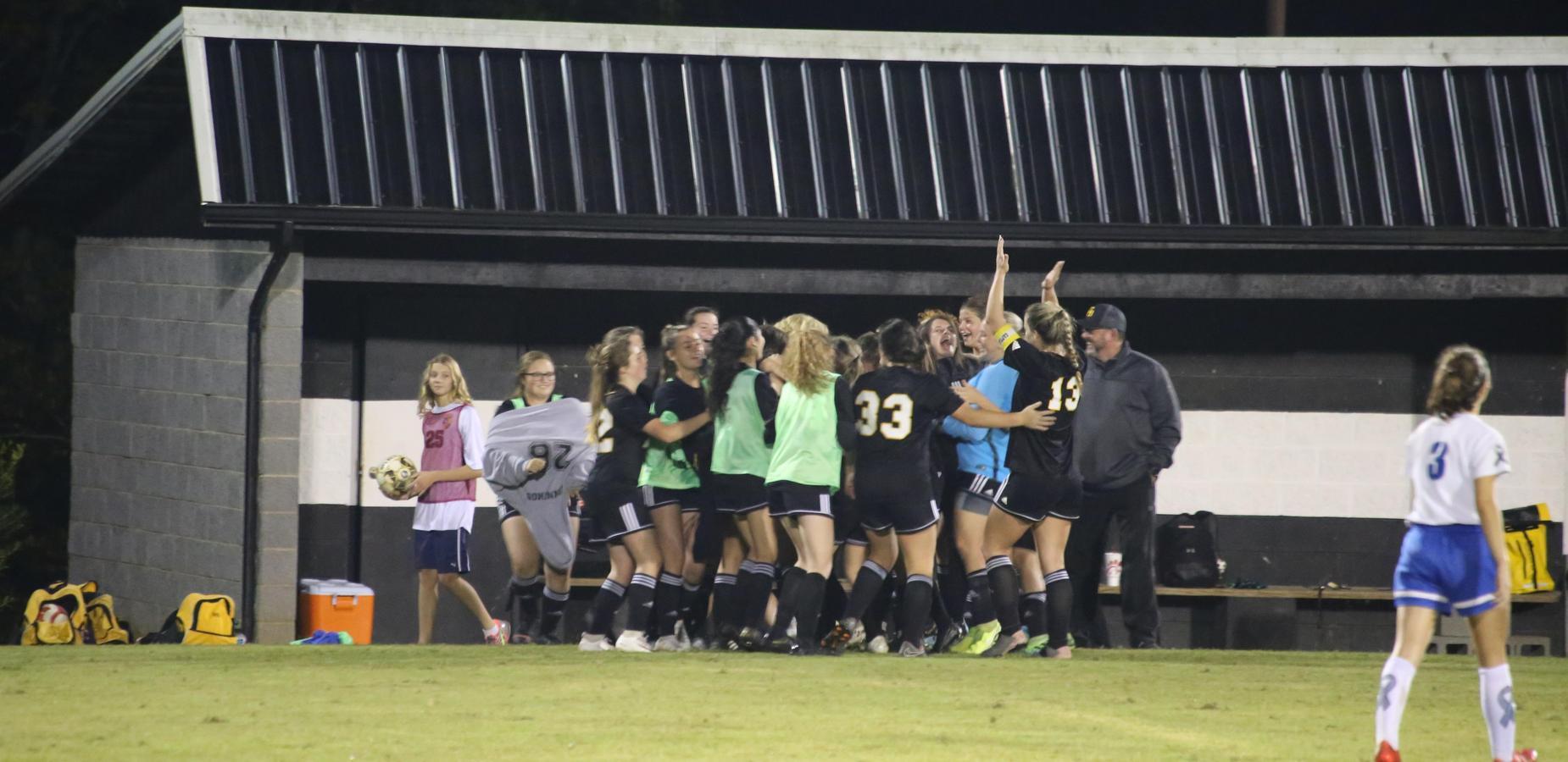 Ladies' soccer team celebrates regional win